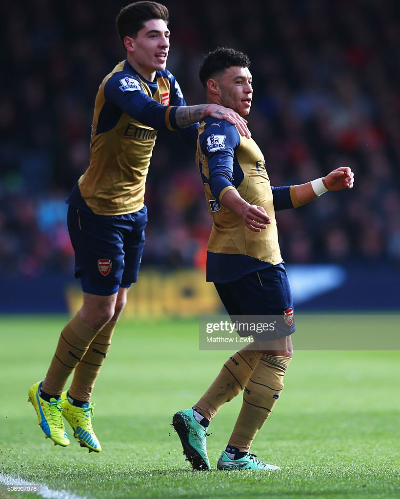 <a gi-track='captionPersonalityLinkClicked' href=/galleries/search?phrase=Alex+Oxlade-Chamberlain&family=editorial&specificpeople=7191518 ng-click='$event.stopPropagation()'>Alex Oxlade-Chamberlain</a> of Arsenal (R) celebrates with Hector Bellerin as he scores their second goal during the Barclays Premier League match between A.F.C. Bournemouth and Arsenal at the Vitality Stadium on February 7, 2016 in Bournemouth, England.