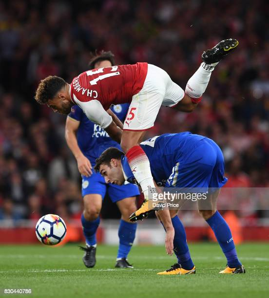 Alex OxladeChamberlain of Arsenal challenges Matty James of Leicester during the Premier League match between Arsenal and Leicester City at Emirates...