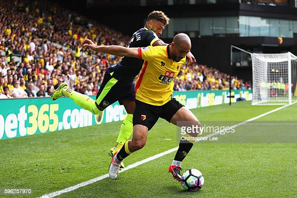 Alex OxladeChamberlain of Arsenal challenges Nordin Amrabat of Watford during the Premier League match between Watford and Arsenal at Vicarage Road...