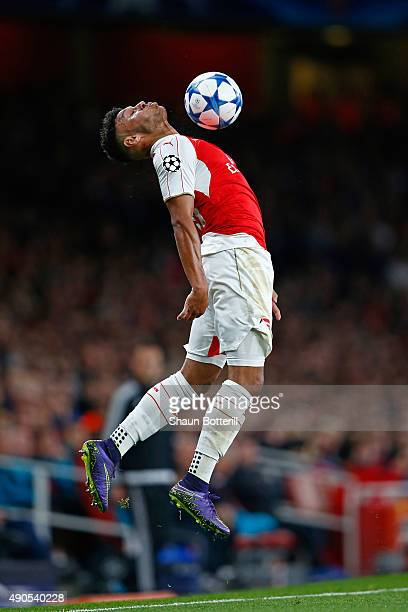 Alex OxladeChamberlain of Arsenal controls the ball during the UEFA Champions League Group F match between Arsenal FC and Olympiacos FC at the...