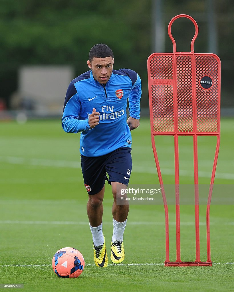ST. ALBANS, ENGLAND - Alex Oxlade-Chamberlain of Arsenal during a training session at London Colney on April 11, 2014 in St Albans, England.