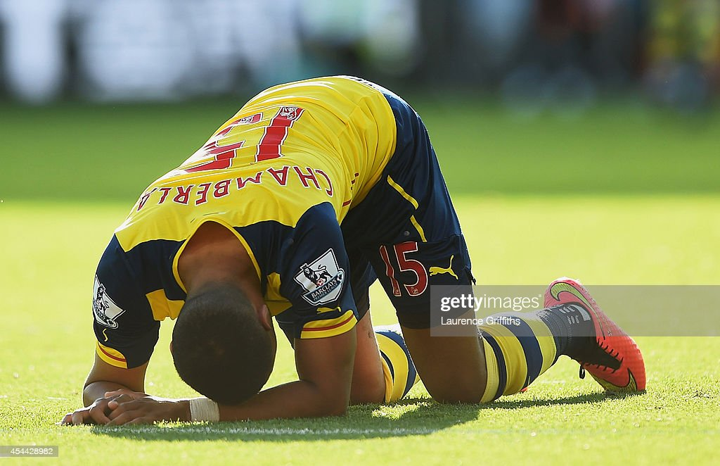 Alex Oxlade-Chamberlain of Arsenal goes to ground during the Barclays Premier League match between Leicester City and Arsenal at The King Power Stadium on August 31, 2014 in Leicester, England.