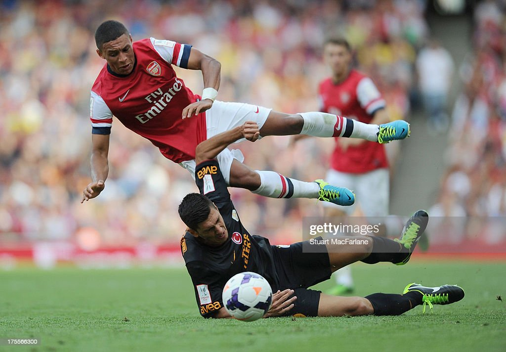 Alex Oxlade-Chamberlain of Arsenal is fouled by Ceyhun Gulselam og Galatasaray during the Emirates Cup match between Arsenal and Galatasaray at the Emirates Stadium on August 04, 2013 in London, England.