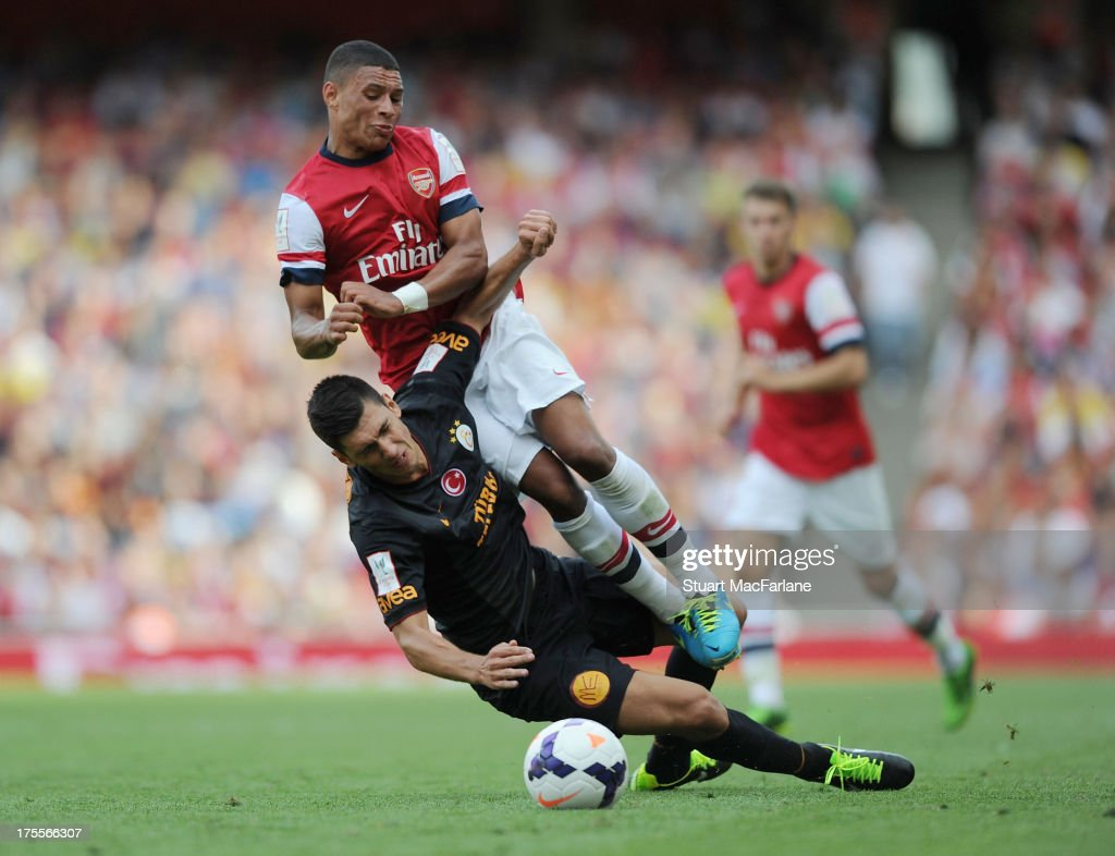 <a gi-track='captionPersonalityLinkClicked' href=/galleries/search?phrase=Alex+Oxlade-Chamberlain&family=editorial&specificpeople=7191518 ng-click='$event.stopPropagation()'>Alex Oxlade-Chamberlain</a> of Arsenal is fouled by Ceyhun Gulselam og Galatasaray during the Emirates Cup match between Arsenal and Galatasaray at the Emirates Stadium on August 04, 2013 in London, England.