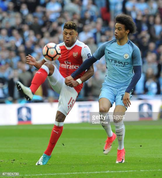 Alex OxladeChamberlain of Arsenal knocks the ball past Leroy Sane of Manchester City during the match between Arsenal and Manchester City at Wembley...