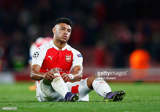 Alex OxlaideChamberlain of Arsenal looks dejected at the end of the UEFA Champions League Group F match between Arsenal FC and Olympiacos FC at the...