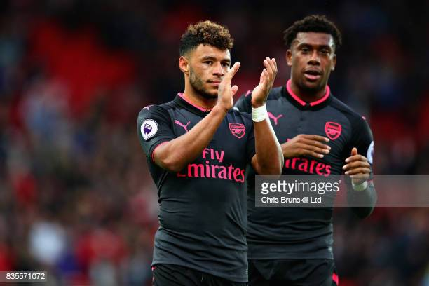Alex OxladeChamberlain of Arsenal looks dejected following the Premier League match between Stoke City and Arsenal at Bet365 Stadium on August 19...