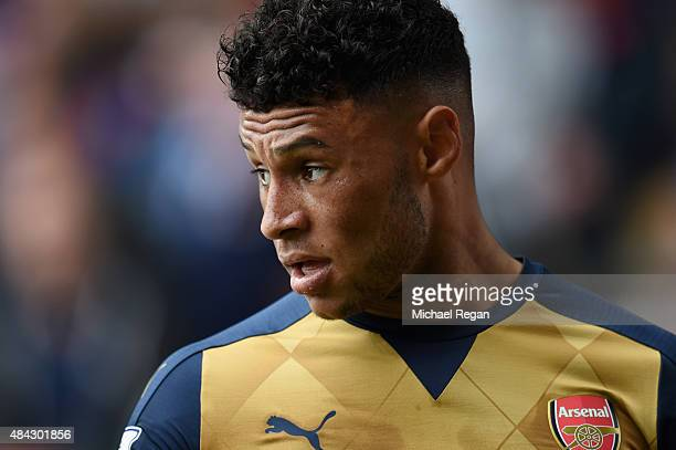 Alex OxladeChamberlain of Arsenal looks on during the Barclays Premier League match between Crystal Palace and Arsenal on August 16 2015 in London...