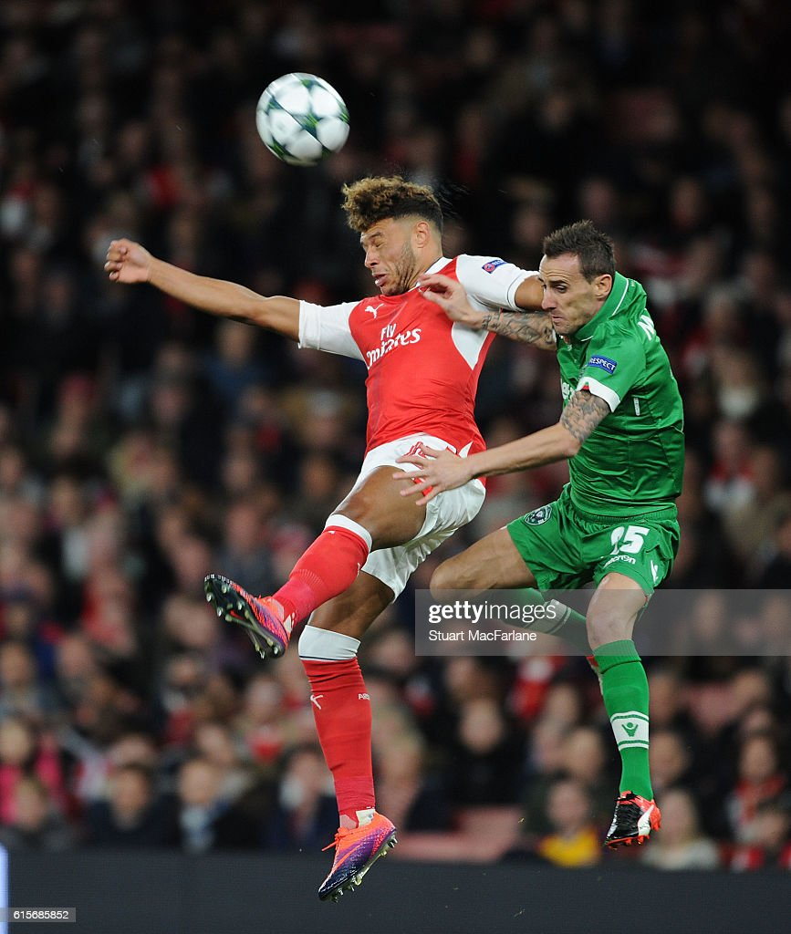 Alex Oxlade-Chamberlain of Arsenal outjumps Yordan Minev of Ludogorets during the UEFA Champions League match between Arsenal FC and PFC Ludogorets Razgrad at Emirates Stadium on October 19, 2016 in London, England.