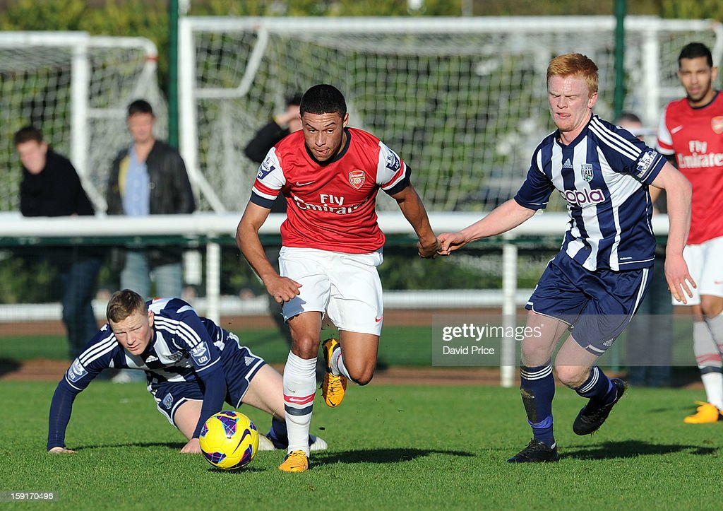 Alex Oxlade-Chamberlain of Arsenal races away from Sam Mantom and Liam O'Neil of WBA during the Barclays Premier U21 match between Arsenal U21 and West Bromwich Albion U21 at London Colney on January 9, 2013 in St Albans, United Kingdom.
