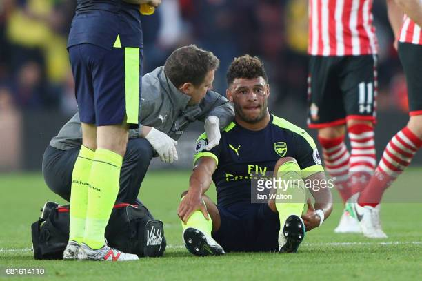 Alex OxladeChamberlain of Arsenal receives treatment before leaving the field injured during the Premier League match between Southampton and Arsenal...