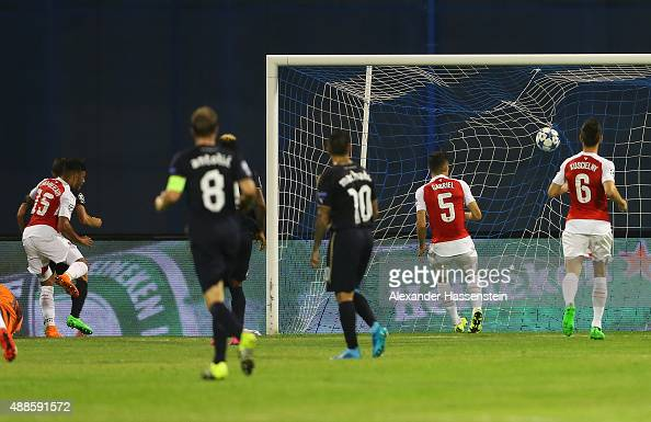Alex OxladeChamberlain of Arsenal scores an own goal for Zagreb's first goal during the UEFA Champions League Group F match between Dinamo Zagreb and...