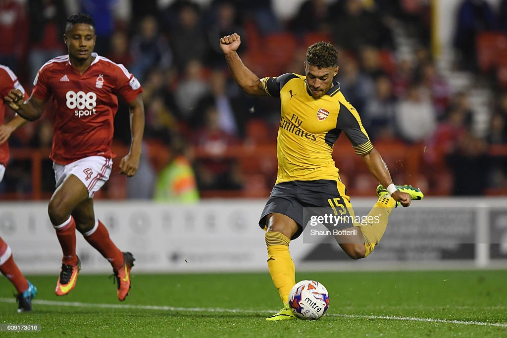 Alex Oxlade-Chamberlain of Arsenal scores his team's fourth goal during the EFL Cup Third Round match between Nottingham Forest and Arsenal at City Ground on September 20, 2016 in Nottingham, England.