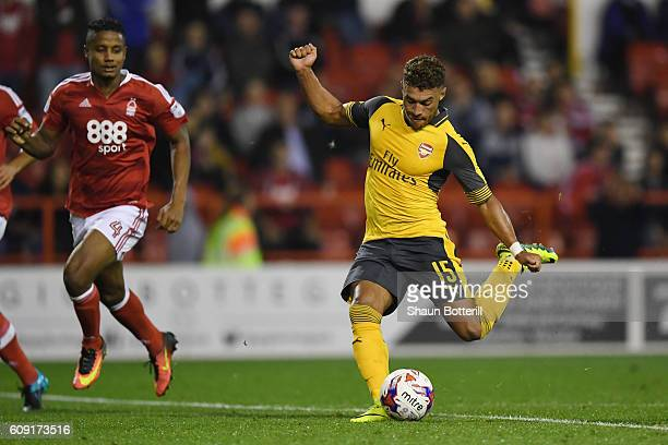 Alex OxladeChamberlain of Arsenal scores his team's fourth goal during the EFL Cup Third Round match between Nottingham Forest and Arsenal at City...