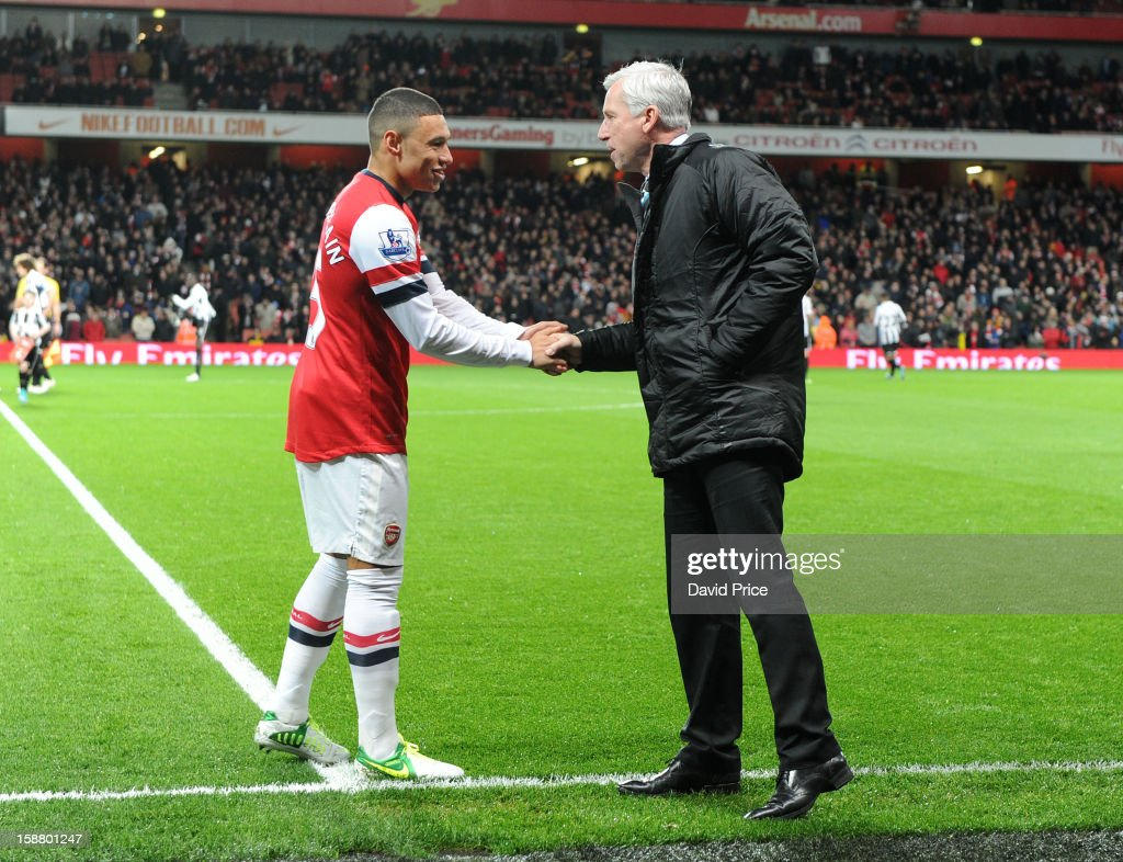 Alex Oxlade-Chamberlain of Arsenal shakes hands with Alan Pardew the Newcastle Manager before the Barclays Premier League match between Arsenal and Newcastle United at Emirates Stadium on December 29, 2012 in London, England.