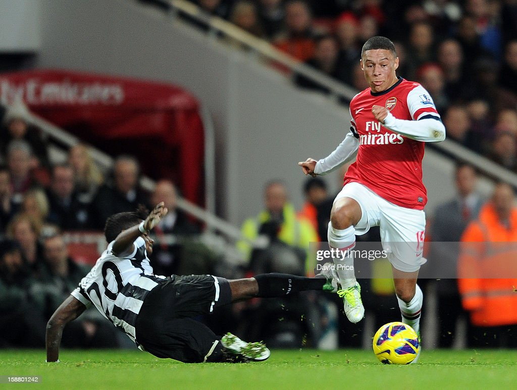 Alex Oxlade-Chamberlain of Arsenal skips past Gael Bigirimana of Newcastle during the Barclays Premier League match between Arsenal and Newcastle United at Emirates Stadium on December 29, 2012 in London, England.