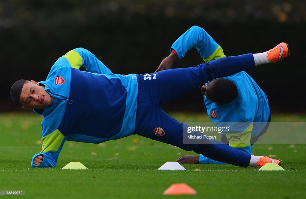 Alex Oxlade-Chamberlain of Arsenal stretches during an Arsenal training session ahead of the UEFA Champions League match against RSC Anderlecht at London Colney on November 3, 2014 in St Albans, England.