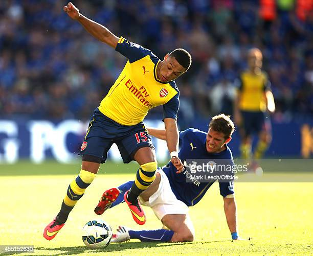 Alex OxladeChamberlain of Arsenal stumbles after being tackled during the Premier League match between Leicester City and Arsenal at The King Power...