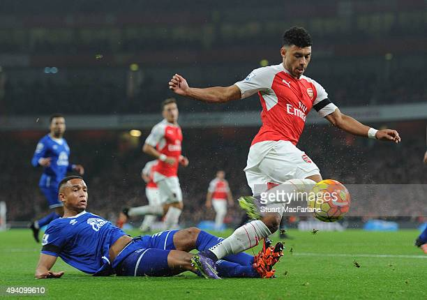 Alex OxladeChamberlain of Arsenal tackled by Brendan Galloway of Everton during the Barclays Premier League match between Arsenal and Everton at...