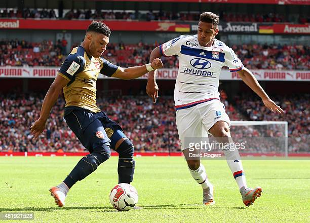 Alex OxladeChamberlain of Arsenal takes on Corentin Tolisso during the Emirates Cup match between Arsenal and Olympique Lyonnais at the Emirates...