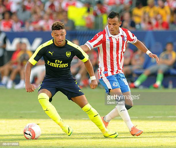 Alex OxladeChamberlain of Arsenal takes on Daniel Gonzalez of CD Guadalajara during the match between Arsenal and CD Guadalajara at StubHub Center on...