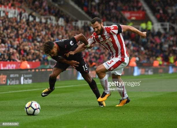 Alex OxladeChamberlain of Arsenal takes on Erik Pieters of Stoke during the Premier League match between Stoke City and Arsenal at Bet365 Stadium on...