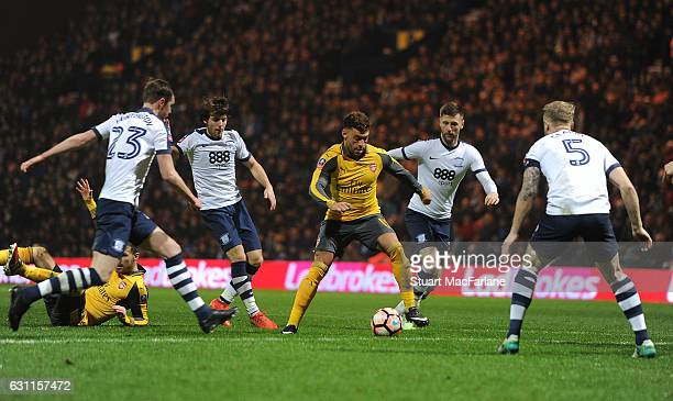 Alex OxladeChamberlain of Arsenal takes on Greg Cunningham and Tom Clarke of Preston during the Emirates FA Cup Third Round match between Preston...