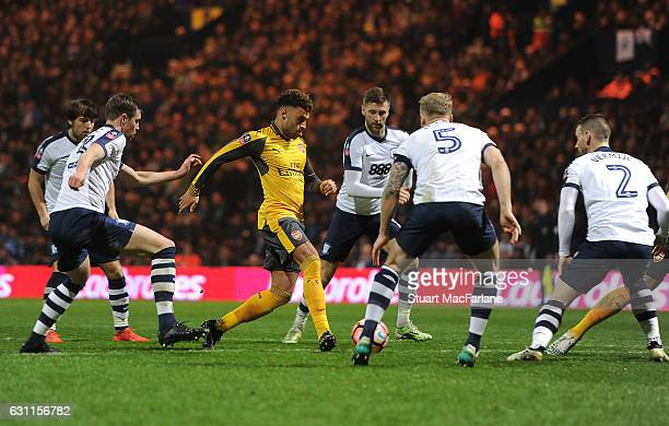 Alex OxladeChamberlain of Arsenal takes on Greg Cunningham Tom Clarke and Marnick Vermijl of Preston during the Emirates FA Cup Third Round match...