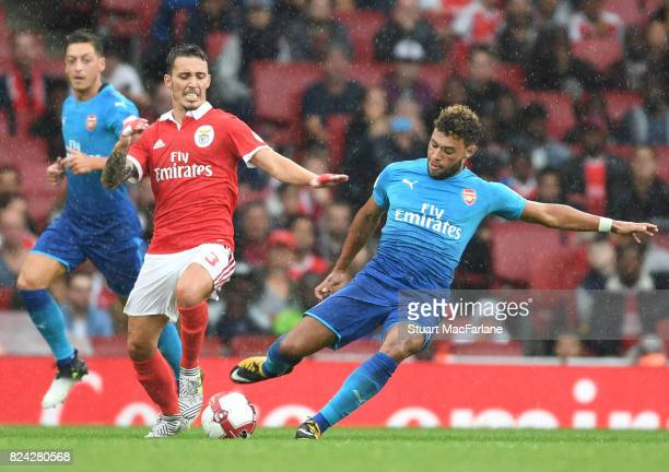 Alex OxladeChamberlain of Arsenal takes on Grimaldo of Benfica during the Emirates Cup match between Arsenal and SL Benfica at Emirates Stadium on...