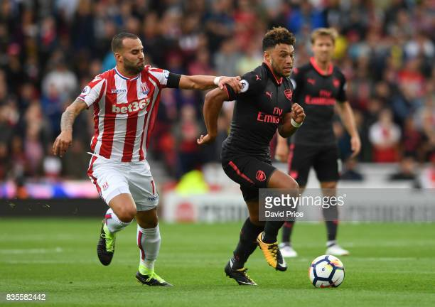 Alex OxladeChamberlain of Arsenal takes on Jese of Stoke during the Premier League match between Stoke City and Arsenal at Bet365 Stadium on August...