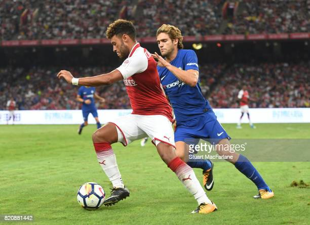 Alex OxladeChamberlain of Arsenal takes on Marco Alonso of Chelsea during the pre season friendly between Arsenal and Chelsea at the Birds Nest on...