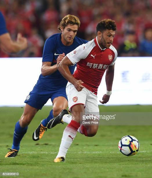 Alex OxladeChamberlain of Arsenal takes on Marcos Alonso of Chelsea during the match between Arsenal and Chelsea at Birds Nest on July 22 2017 in...