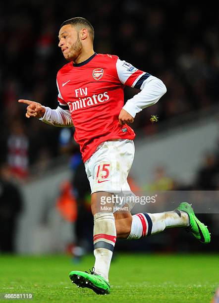 Alex OxladeChamberlain of Arsenal turns to celebrate after scoring his second goal during the Barclays Premier League match between Arsenal and...