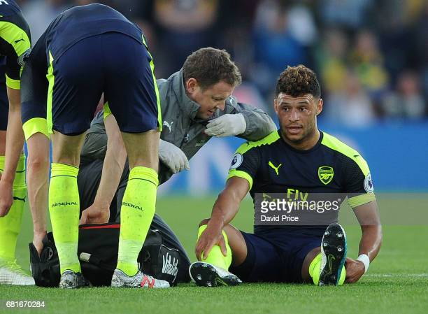 Alex OxladeChamberlain of Arsenal with Arsenal Physio Colin Lewin during the Premier League match between Southampton and Arsenal at St Mary's...
