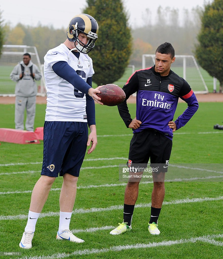 Alex Oxlade-Chamberlain of Arsenal with Johnny Hekker of the St Louis Rams at London Colney on October 24, 2012 in St Albans, England.