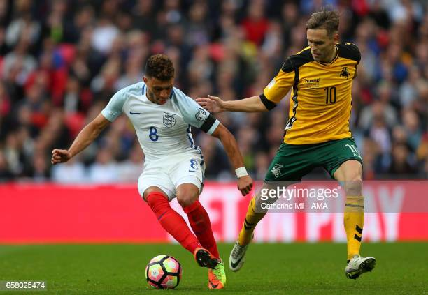 Alex OxladeChamberlain of England and Arturas Zulpa of Lithuania compete during the FIFA 2018 World Cup Qualifier between England and Lithunania at...