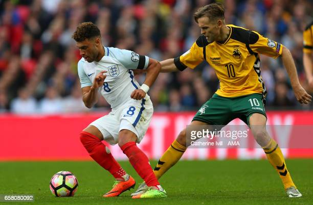 Alex OxladeChamberlain of England and Arturas Zulpa of Lithuania during the FIFA 2018 World Cup Qualifier between England and Lithunania at Wembley...