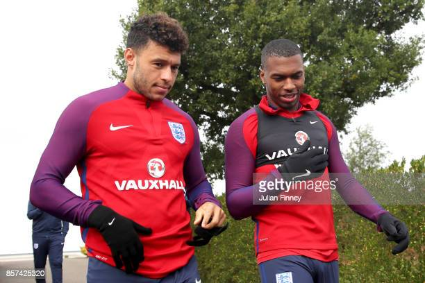 Alex OxladeChamberlain of England and Daniel Sturridge of England walk out prior to a England Training Session at the Tottenham Hotspur training...
