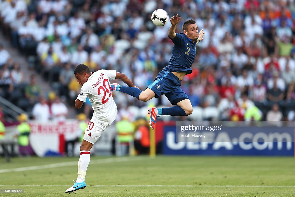 Alex OxladeChamberlain of England and Mathieu Debuchy of France battle for the ball during the UEFA EURO 2012 group D match between France and...