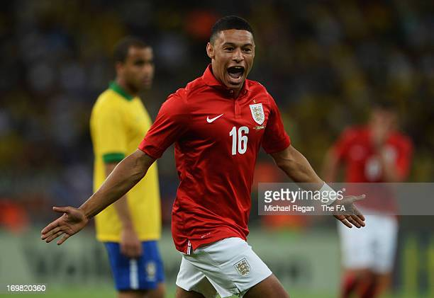 Alex OxladeChamberlain of England as he scores their first and equalising goal during the International Friendly match between Brazil and England at...