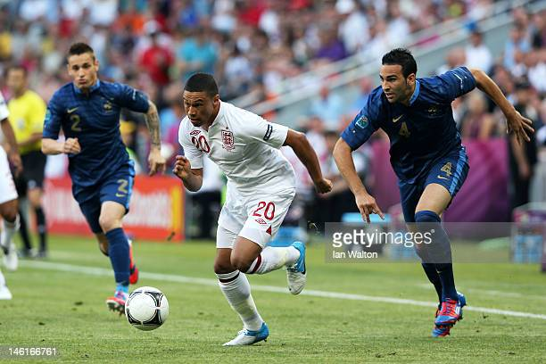 Alex OxladeChamberlain of England breaks away from Adil Rami of France during the UEFA EURO 2012 group D match between France and England at Donbass...