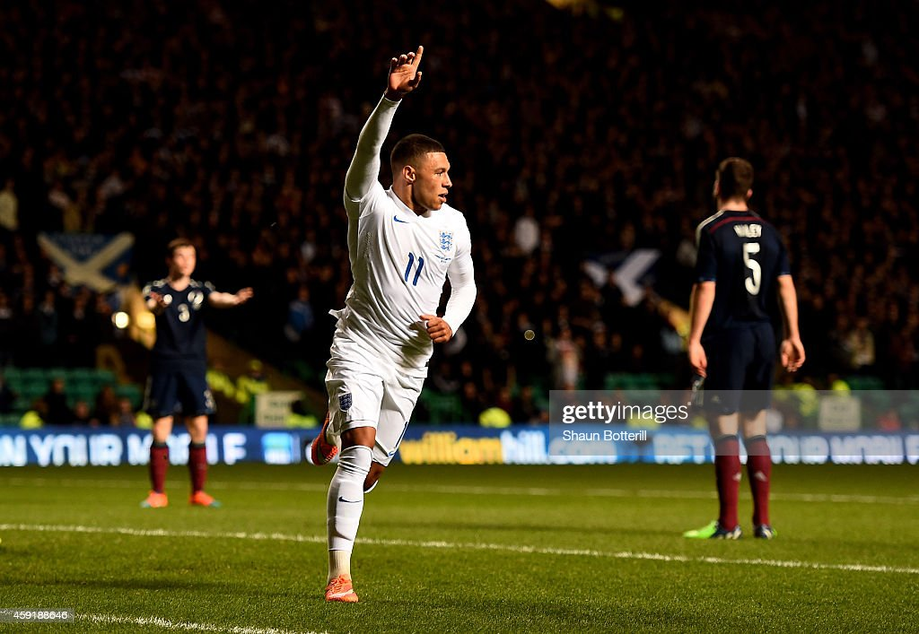 <a gi-track='captionPersonalityLinkClicked' href=/galleries/search?phrase=Alex+Oxlade-Chamberlain&family=editorial&specificpeople=7191518 ng-click='$event.stopPropagation()'>Alex Oxlade-Chamberlain</a> of England celebrates after scoring the opening goal during the International Friendly match between Scotland and England at Celtic Park Stadium on November 18, 2014 in Glasgow, Scotland.