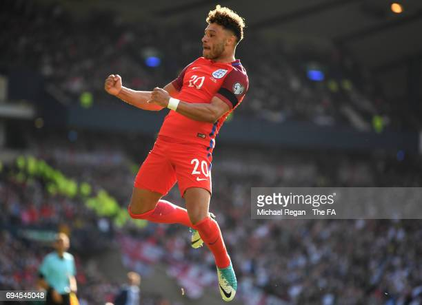 Alex OxladeChamberlain of England celebrates scoring his sides first goal during the FIFA 2018 World Cup Qualifier between Scotland and England at...