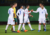 Alex OxladeChamberlain of England celebrates with Adam Lallana as he scores their third goal during the UEFA EURO 2016 qualifying Group E match...