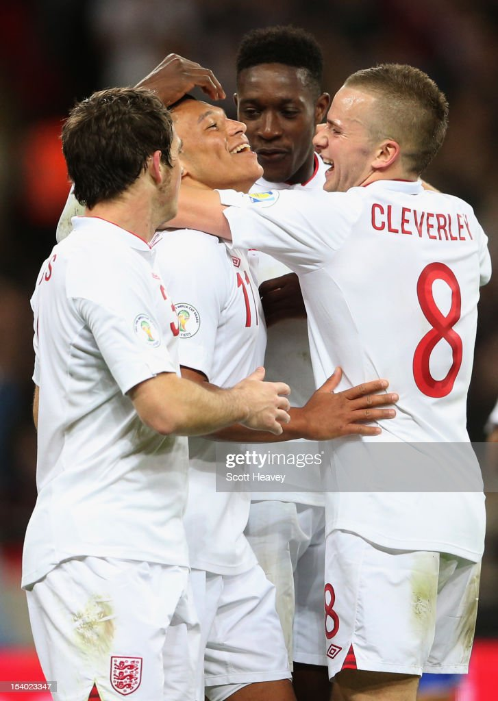 Alex Oxlade-Chamberlain of England celebrates with team-mates (L-R) Leighton Baines, Danny Welbeck and Tom Cleverley after scoring his team's fifith goal during the FIFA 2014 World Cup Group H qualifying match between England and San Marino at Wembley Stadium on October 12, 2012 in London, England.