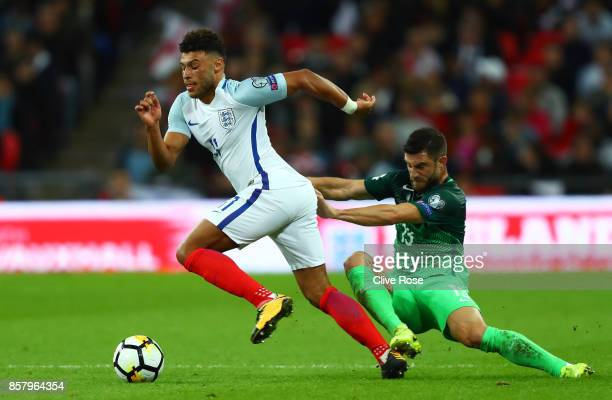 Alex OxladeChamberlain of England evades Bojan Jokic of Slovenia during the FIFA 2018 World Cup Group F Qualifier between England and Slovenia at...