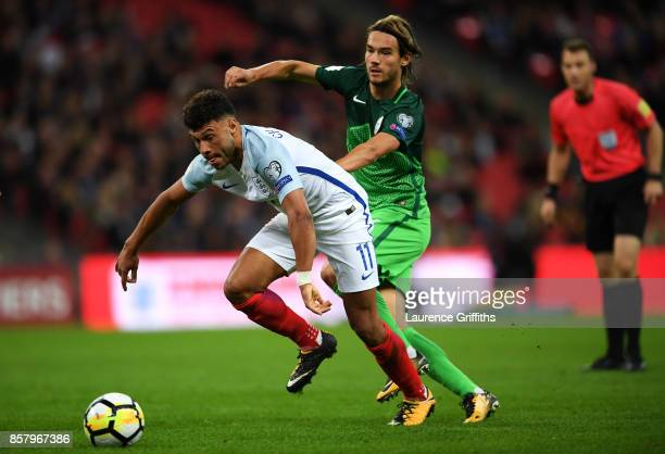 Alex OxladeChamberlain of England evades Rene Krhin of Slovenia during the FIFA 2018 World Cup Group F Qualifier between England and Slovenia at...