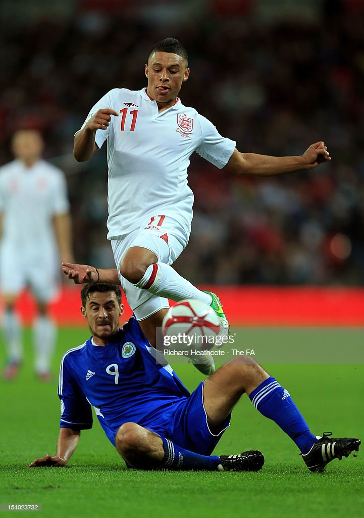 <a gi-track='captionPersonalityLinkClicked' href=/galleries/search?phrase=Alex+Oxlade-Chamberlain&family=editorial&specificpeople=7191518 ng-click='$event.stopPropagation()'>Alex Oxlade-Chamberlain</a> of England hurdles the challenge from Michele Cervellini of San Marino during the FIFA 2014 World Cup Group H qualifying match between England and San Marino at Wembley Stadium on October 12, 2012 in London, England.