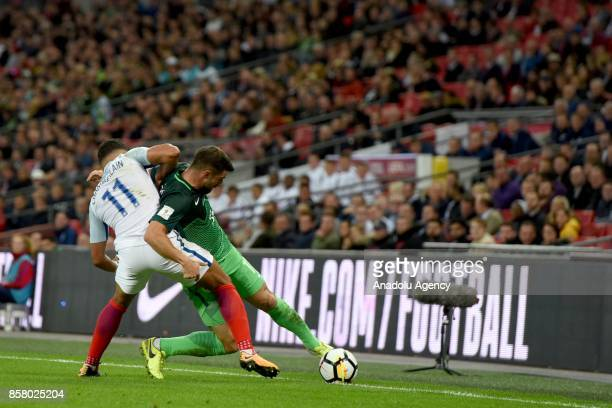 Alex OxladeChamberlain of England in action against Andraz Sporar of Slovenia during the 2018 FIFA World Cup European Qualification football match...