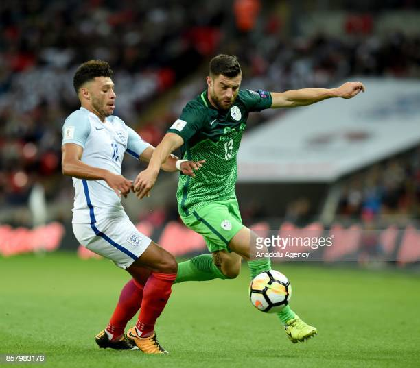 Alex OxladeChamberlain of England in action against Bojan Jokic of Slovenia during the 2018 FIFA World Cup European Qualification football match...